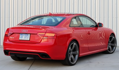 A three-quarter rear view of a 2013 Audi RS 5 Coupe