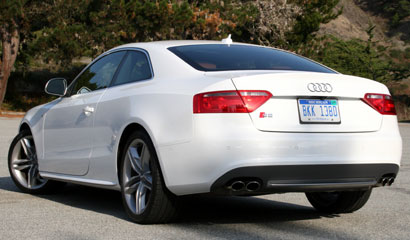 A three-quarter rear view of a white 2008 Audi S5