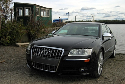 A three-quarter front view of a black 2007 Audi S8 in Quebec, Canada
