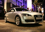 A three-quarter front view of a silver 2008 Audi TT Coupe 2.0