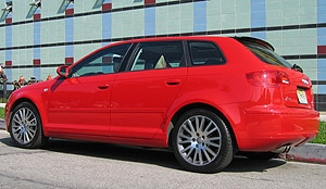 A three-quarter rear view of a red 2006 Audi A3 2.0 T MT6