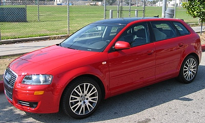 A three-quarter front view of a red 2006 Audi A3 2.0 T MT6