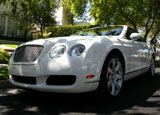 A three-quarter front view of a white 2007 Bentley Continental GTC