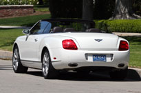 A three-quarter rear view of a white 2007 Bentley Continental GTC