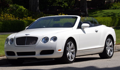 A three-quarter front view of a a white 2007 Bentley Continental GTC