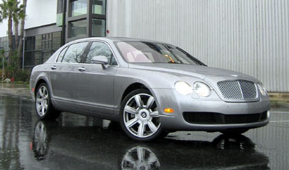 A three-quarter front view of a silver Bentley Continental Flying Spur