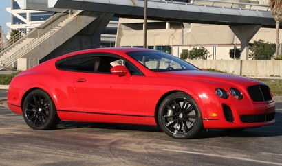 A three-quarter front view of a red 2010 Bentley Continental Supersports