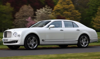 A side view of a white 2011 Bentley Mulsanne
