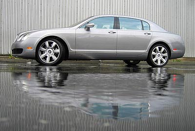 A side view of a gray Bentley Continental Flying Spur