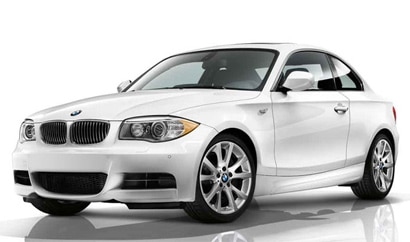 A three-quarter front view of a white 2012 BMW 135i Coupe
