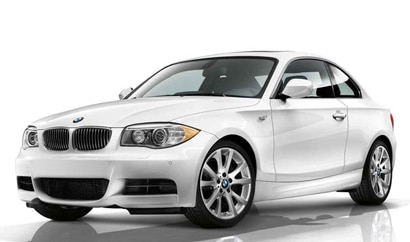 A three-quarter front view of a white 2012 BMW 135i