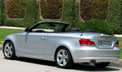 A three-quarter rear view of a gray 2008 BMW 128i Convertible