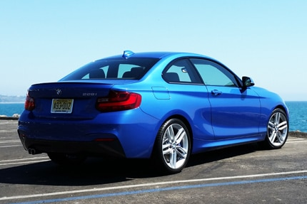 A three-quarter rear view of the 2015 BMW 228i Coupe