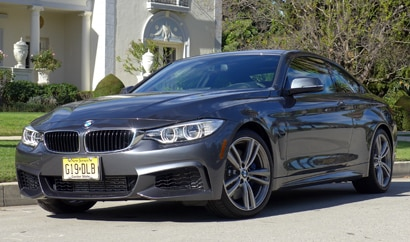 A three-quarter front view of the 2014 BMW 435i Coupe
