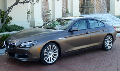A three-quarter front view of a 2013 BMW 640i Gran Coupe