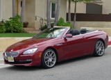 A three-quarter front view of a red 2012 BMW 650i Convertible