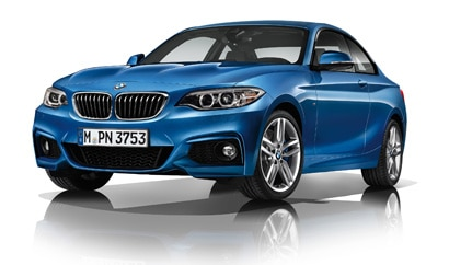 A three-quarter front view of a blue 2014 BMW 228i