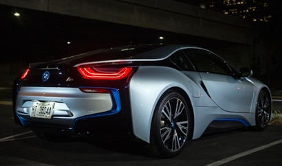 A three-quarter rear view of the 2015 BMW i8