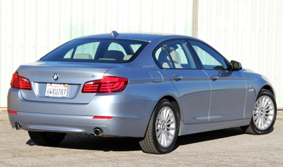 A three-quarter rear view of a 2013 BMW ActiveHybrid 5