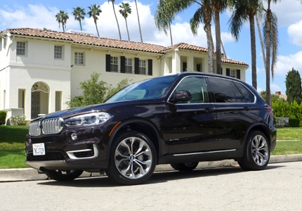 A three-quarter front view of the 2016 BMW xDrive 40e SUV, GAYOT's Car of the Month for July 2016