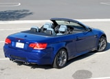 A three-quarter rear view of a blue 2011 BMW M3 Convertible