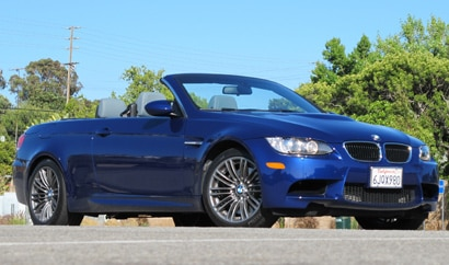 A three-quarter front view of a blue 2010 BMW M3 Convertible