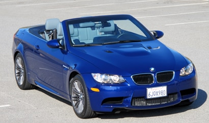 A three-quarter front view of a blue 2010 M3 Convertible