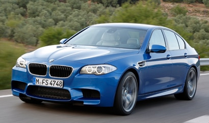 A three-quarter front view of a 2013 BMW M5