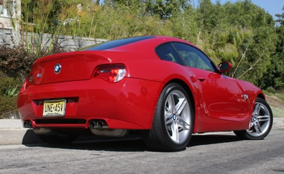 A three-quarter rear view of a red 2006 BMW M Coupe