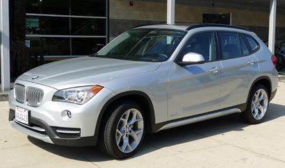 A three-quarter front view of a 2013 BMW X1 xDrive28i