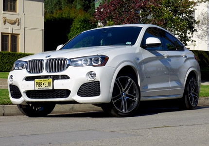 A three-quarter front view of the BMW X4