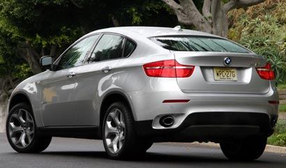 A three-quarter rear view of a silver 2008 BMW X6 xDrive35i