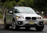 A front view of a silver BMW X6