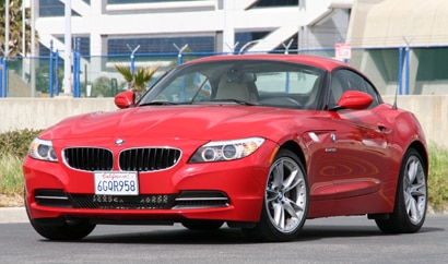 A three-quarter front view of a red 2010 BMW Z4 sDrive30i