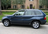 A side view of a blue 2006 BMW X5