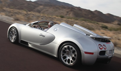 A three-quarter rear view of the 2010 Bugatti Veyron 16.4 Grand Sport in action