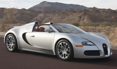 A three-quarter front view of a silver 2010 Bugatti Veyron 16.4 Grand Sport