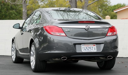 A three-quarter rear view of a black 2011 Buick Regal CXL Turbo