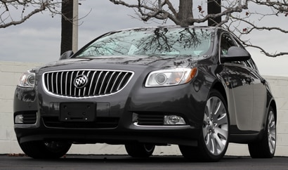 A three-quarter front view of a black 2011 Buick Regal CXL Turbo