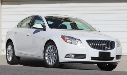 A three-quarter front view of a white 2011 Buick Regal