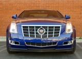 A front view of a blue 2012 Cadillac CTS Coupe Premium Collection