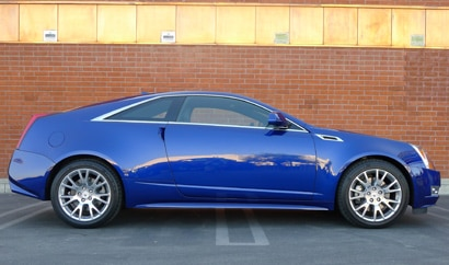 A side view of a blue 2012 Cadillac CTS Coupe Premium Collection