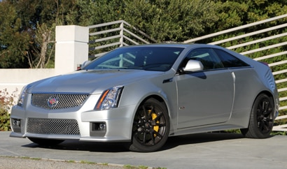 A three-quarter front view of a silver 2011 Cadillac CTS-V Coupe