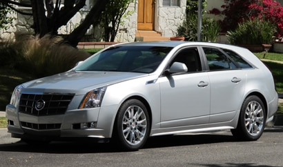 A three-quarter front view of a silver 2010 Cadillac CTS Sport Wagon