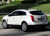 A three-quarter rear view of a white 2010 Cadillac SRX Turbo AWD Premium
