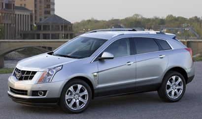 A three-quarter front view of a silver Cadillac SRX