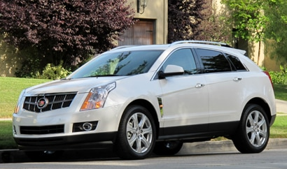 A three-quarter front view of a white 2010 Cadillac SRX Turbo AWD Premium