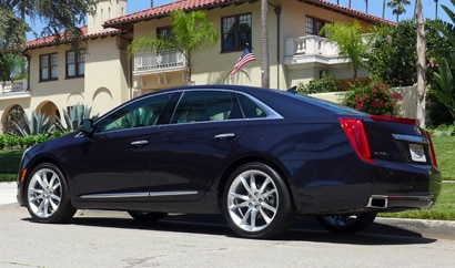 A three-quarter rear view of a 2013 Cadillac XTS AWD Premium Collection