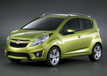 A three-quarter front view of a lime-green 2010 Chevrolet Spark