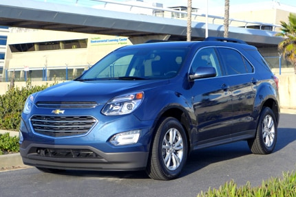 A three quarter front view of the 2016 Chevrolet Equinox FWD LT in patriot blue metallic